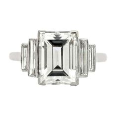 Thin line emerald cut setting  Art Deco diamond ring, circa 1935. | From a unique collection of vintage engagement rings at http://www.1stdibs.com/jewelry/rings/engagement-rings/