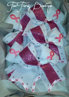 Breast cancer awareness cheer bow.  Great for pink out game!! Team orders by Two Tiara's Bowtique on Etsy or Facebook group for more options and recent updates.  Etsy listing at https://www.etsy.com/listing/202800893/pink-out-cheer-bow-for-breast-cancer please do not copy my designs! Be inspired, but use your own creative imagination.  :)