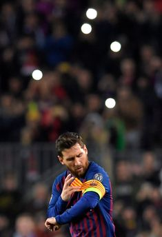 Barcelona's Argentinian forward Lionel Messi adjusts the captain's armband during the UEFA Champions League group B football match between FC Barcelona and Tottenham Hotspur at the Camp Nou stadium in Barcelona on December 11, 2018. (Photo by LLUIS GENE / AFP) (Photo credit should read LLUIS GENE/AFP/Getty Images)