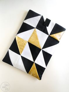A great tutorial for making your own geometric laptop sleeve. Love those little gold triangles!