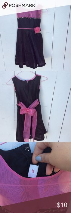 Pink and black party dress Adorable handmade girls party dress with a black silk skirt and bodice. Hand embroidered detail with pearl beads along the bust, and cute rosette on the waist. Back zip closure with a tying belt. Moms and Tots Dresses Formal