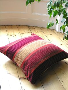 Moroccan shades of red and orange striped silk floor cushion Moroccan Lamp, Glass Floor, Floor Cushions, Shades Of Red, Soft Furnishings, Lanterns, Throw Pillows, Flooring, Wallpaper