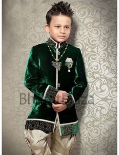 Classic dark green color velvet indo western sherwani is having excellent design. Comes with dark beige color breeches.