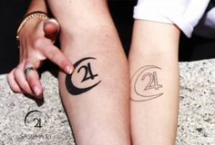 Forearm matching tattoos of the jupiter symbol and the moon....