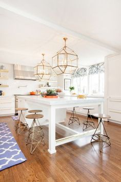 VC Lighting. White and brass kitchen, Love the valances too. Eat in kitchen island design