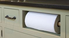 paper towel holder in cabinet in kitchen