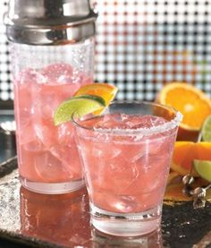 TGI Friday's Patron Cosmorita     1 oz Patron Tequila   1/2 oz triple sec   1/2 oz fresh lime juice   1/2 oz cranberry juice     Shake tequila, triple sec, lime and cranberry juice vigorously in a shaker  with ice. Strain into a margarita glass, garnish with a lime wedge on the  rim, and serve.    Don't forget the salt ;)