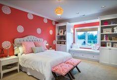Bedroom. Kids Bedroom Ideas. Kids Bedroom with stencilled walls. Girls bedroom features painted coral walls, custom tufted headboard, custom x benches, nightstands, custom painted bookshelves, window seat with bench, woven roman shades, Etsy Dahlia wall decals. #Bedroom #KidsBedroom