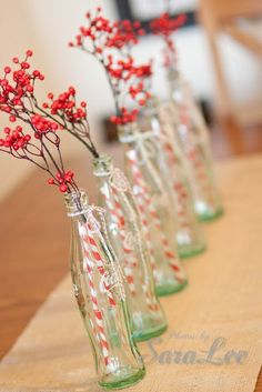 paint branches white and use flower vases with red ribbon