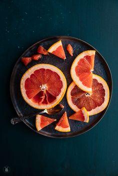 Grapefruit. Dark food photography. Owl's Kitchen. Sasha O