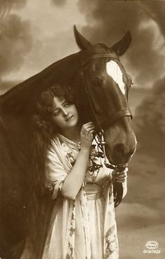 Young lady with long hair and beautiful horse