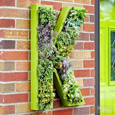 Whether placed on your front door or beside it, a wreath is a simple way to personalize your entry. Find more project to boost your curb appeal here: http://www.bhg.com/home-improvement/exteriors/curb-appeal/curb-appeal-on-a-dime/?socsrc=bhgpin031215livingmonogram&page=6