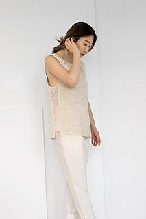 This statement piece features a classic square neckline that is high in the front and lower in the back. Off-set, sheer, side panels give unexpected yet sophisticated flair.