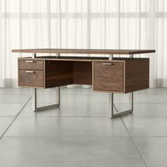 Shop Clybourn Walnut Executive Desk. Designer Blake Tovin's mid-century modern design suspends two walnut storage drawers opposite one legal-letter file with brushed aluminum pulls.