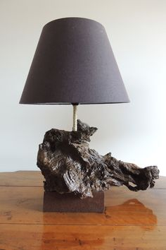 This is made in Italy with from Central Italy and with a antique iron base. Driftwood Centerpiece, Driftwood Lamp, Driftwood Projects, Wooden Lamp, Wooden Decor, Laser Cut Lamps, Rustic Lighting, Woodworking Projects Diy, Nature Decor