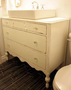Antique dresser turned vanity...should think about this for my upstairs bathroom.