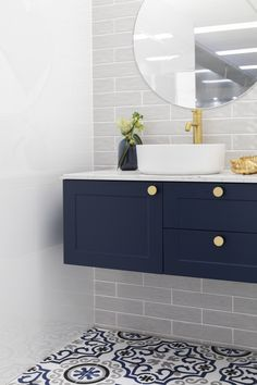Patterned blue floor tile Atelier 240x240. Gloss White Rectified wall tiles 300x600. Small subway tiles Light Grey Atlantis 75x300. Navy blue vanity (Highgrove bathrooms), gold tapware  (Highgrove bathrooms), matt white basin (The Bathroom Outlet).