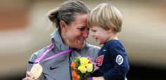 US cyclist Kristin Armstrong celebrates winning gold with her son, Lucas.