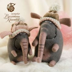 Cute felted elephants with woolly hats
