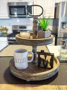 """Looking for that perfect tiered tray for a coffee bar or a guest bathroom? This is that tray! So versatile for all those decorating projects. 15"""" round x 18 ½"""" tall."""