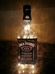 Jack Daniels bottle filled with lights.