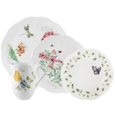 This scallop-rimmed place setting is filled with colorful butterflies and flowers, evoking the beauty of butterfly meadows. Place setting includes a dragonfly dinner plate, tiger swallowtail accent, individual pasta bowl and dragonfly mug.