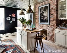Love the dark accent wall and the brick. . .Although I'd change out the cigarette print for another B & W.