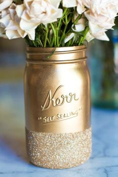 Recycle Mason jars into centerpieces! http://www.lilyshop.com/glitter-dipped-mason-jars