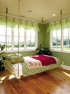 This simple hanging bed was a quick project. A wood frame sized to hold a double mattress is accented with a sun-ray patterned headboard. Braided rope gives the bed a lift and a swing if wanted.