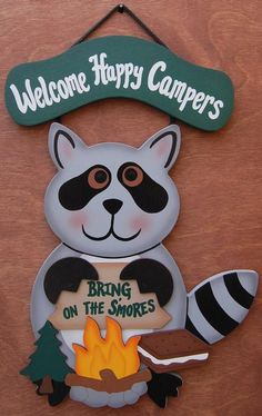"""11""""x 15"""" This handmade campsite raccoon sign will add that welcoming touch to your campground. Welcome Happy Campers sign is made of wood. Raccoon is paintedwith a very high quality gray exterior paint. Raccoon's claws, campfire, tree and """"Bring On The S'mores sign are each separatepieces of wood. Name can be personalized on the campfire with black lettering, for an additional $3.00. Please fill in personalized section."""