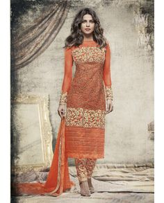 1. Orange embroidered Net suit 2. Embroidery with jari, sequins and stone work  3. Comes with a matching net dupatta finish with lace and stone work 4. Can be stitched upto size 42 inches