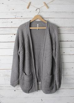 This cool gray cardigan is sure to keep you warm!%0D%0A%0D%0A %0D%0A%0D%0A60% Cotton, 40% Acrylic%0D%0A%0D%0AImported%0D%0A%0D%0A30 inches long (taken from a small, add 1/2 inch for next size up)