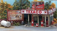 Here's a structure that will add character to your roadside scenes. Bud Smiley's Gas Stop is a neat little vintage gas station kit that features a wooden office/store with an overhead canopy. The model includes vintage gas pumps, a pump island, storage tank, a complete set of signs and other details. Because