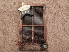 Wooden frame I made with black plaid cloth, Family star, pip berries and electric candle