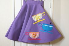 Take a spin in this felt circle skirt, custom made to fit you! Inspired by Disneyland's Mad Tea Party, the purple colored skirt features hand