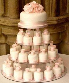 Wedding cake with cupcakes.                              …