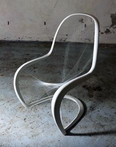 Very cool frame and string interpretation of the famous Panton Chair by Jump Studios.