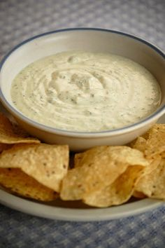 Chuy's Jalapeno Ranch Dip  feeds a crowd    8 ounces mayonaise  24 ounces sour cream  1 cup buttermilk  1 cup tomatillo salsa  1 handful of cilantro  3 ranch dressing packets  1/2 cup pickled jalapenos    Combine all ingredients in a blender; process until smooth.