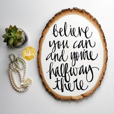 inspirational quote art on a wood slice painting