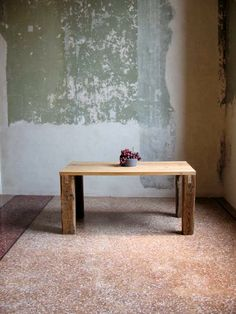 """The rough dining table """"Humboldt"""" is manufactured of recycled pinewood beams. The beams show traces of their former use of lagging on construction site. The legs are beams of an old truss of Scheunenviertel in Berlin. Everything is sanded by hand. Here the table is placed in Neues Museum in Berlin. The reconstruction of the museum is designed by David Chipperfield Architects."""