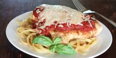Slow Cooker Garlic Parmesan Chicken - Delicious and you will want this on your meal rotation!  www.GetCrocked.com