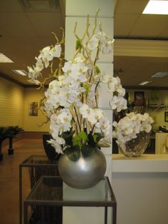 White Orchids in Silver Round Container #Orchids #SilverContainer