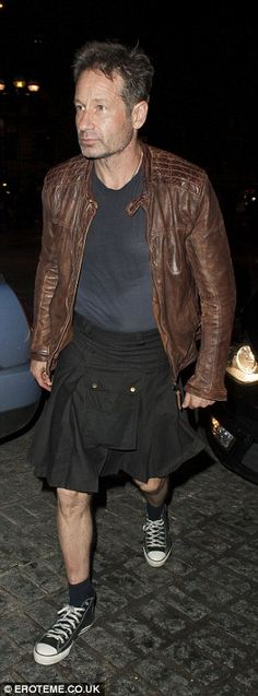 Keeping it casual: The star wore a navy t-shirt, brown leather jacket and black Converse