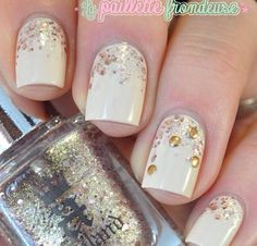 Cream nails with golden flakes accented