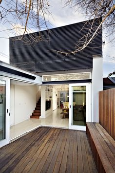 exterior deck with inbuilt seat and metal louvers above to provide privacy