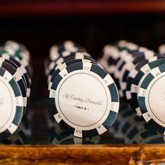 Playing off the casino theme, the escort cards resembled poker chips in the couple's color palette.