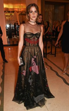 Emma Watson spent Halloween night being honored at Harper's Bazaar UK's Women of the Year awards. But she gave the holiday a subtle nod by wearing this witchy confection from Maria Grazia Chiuri's debut collection for Christian Dior.