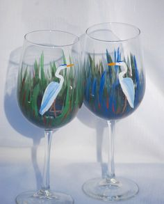 Hand painted wine glasses -  Blue Herons in Marsh Grass by glasschris on Etsy https://www.etsy.com/listing/492774459/hand-painted-wine-glasses-blue-herons-in