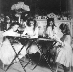 OTMA in the Mauve Room, 1910 - the official consensus on the forum is that they are decorating Easter eggs!
