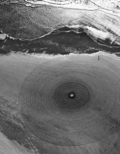 'Earth' Jim Denevan makes temporary drawings on sand earth and ice that are eventually erased by waves and weather.